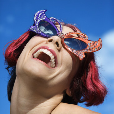Woman wearing unique sunglasses.